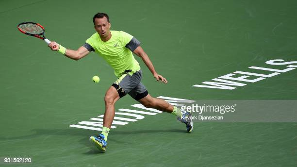 Philipp Kohlschreiber of Germany hits a running forehand against Marin Cilic of Croatia during Day 9 of BNP Paribas Open on March 13 2018 in Indian...