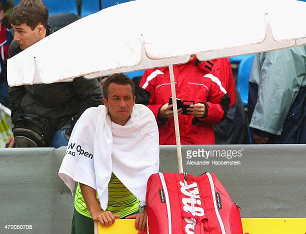 Philipp Kohlschreiber of Germany looks on from the centre court during a rain delay prior to the BMW Open final between Andy Murray of Great Britain...