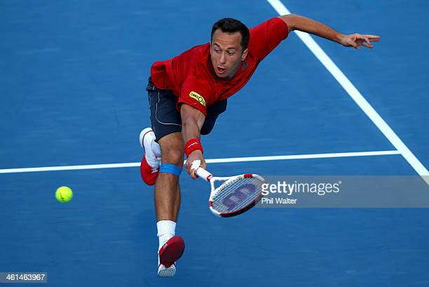 Philipp Kohlschreiber of Germany plays a backhand against John Isner of the USA during day four of the Heineken Open at ASB Tennis Centre on January...