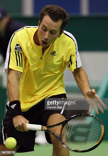 Philipp Kohlschreiber of Germany plays a backhand during his match against Gilles Simon of France during day three of the ABN AMRO World Tennis...