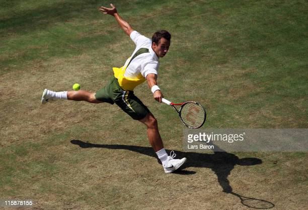 Philipp Kohlschreiber of Germany plays a backhand during his semi final against Gael Monfils of France during day 6 of the Gerry Weber Open at Gerry...