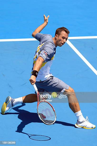 Philipp Kohlschreiber of Germany plays a backhand in his second round match against Alejandro Falla of Colombia during day three of the Heineken Open...