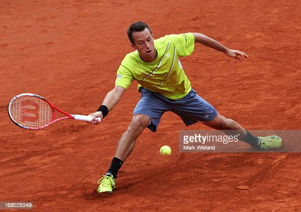 Philipp Kohlschreiber of Germany plays a forehand against Daniel Brands of Germany during the semi final of the BMW Open at Iphitos tennis club on...
