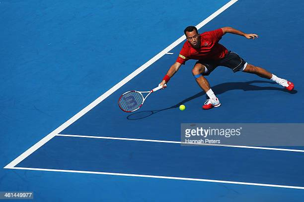 Philipp Kohlschreiber of Germany plays a forehand against John Isner of the USA during day four of the Heineken Open at ASB Tennis Centre on January...