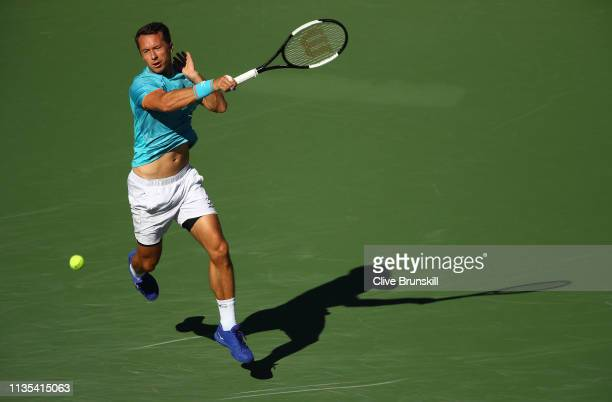 Philipp Kohlschreiber of Germany plays a forehand against Novak Djokovic of Serbia during their men's singles third round match on day nine of the...