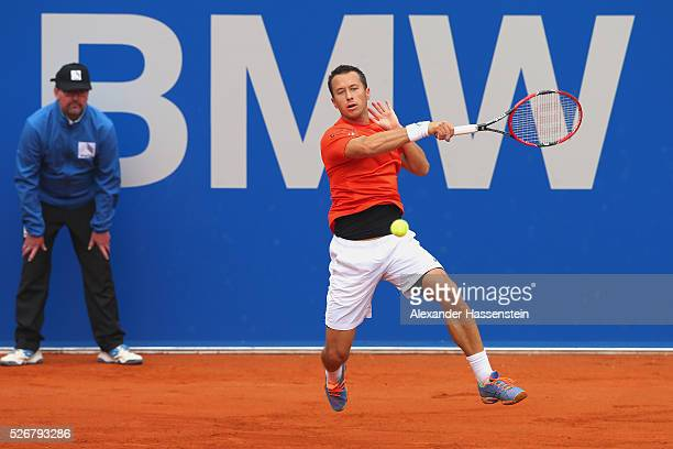 Philipp Kohlschreiber of Germany plays a forehand during his finale match against Dominic Thiem of Austria of the BMW Open at Iphitos tennis club on...