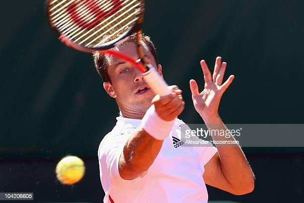 Philipp Kohlschreiber of Germany plays a forehand during his match against Rik de Voest of South Africa at the Davis Cup World Group Play-Off tie...