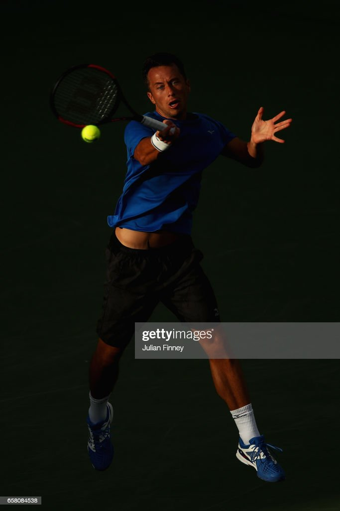 Philipp Kohlschreiber of Germany plays a forehand in his match against Rafael Nadal of Spain at Crandon Park Tennis Center on March 26, 2017 in Key Biscayne, Florida.