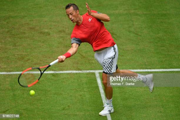 Philipp Kohlschreiber of Germany plays a forehand in his match against Marton Fucsovics of Hungary during day two of the Gerry Weber Open at Gerry...