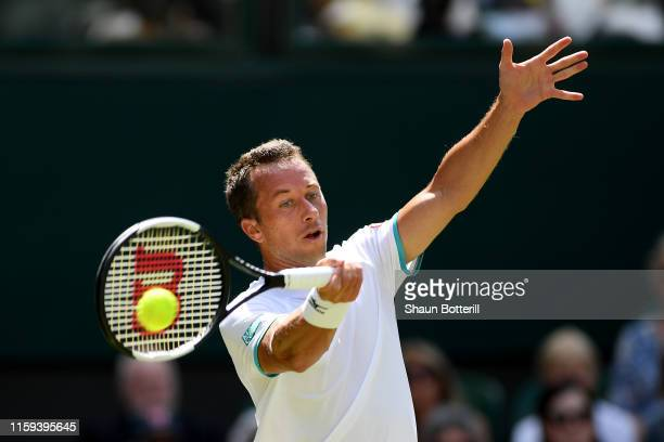 Philipp Kohlschreiber of Germany plays a forehand in his Men's Singles first round match against Novak Djokovic of Serbia during Day one of The...