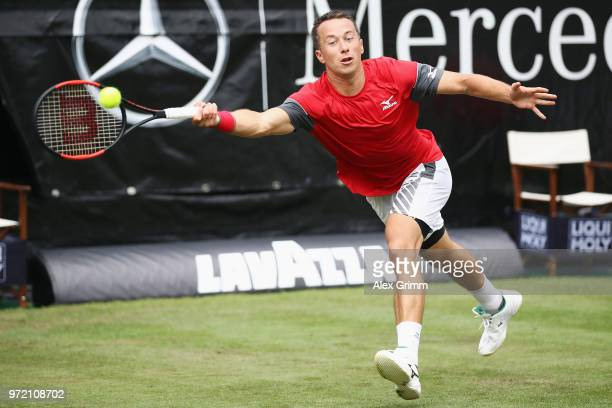 Philipp Kohlschreiber of Germany plays a forehand to Denis Istomin of Uzbekistan during day 2 of the Mercedes Cup at Tennisclub Weissenhof on June 12...