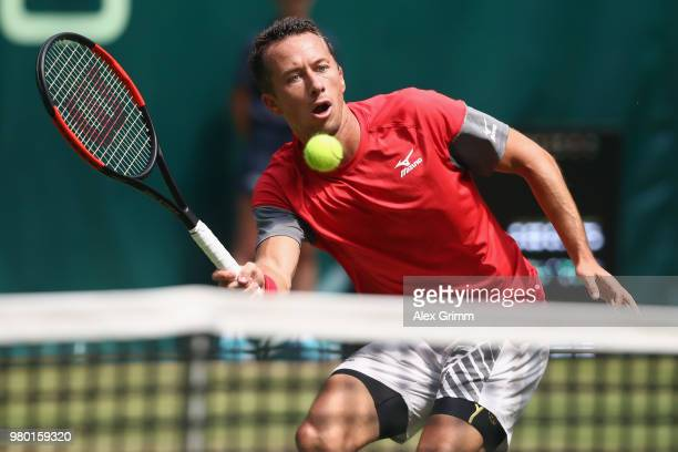 Philipp Kohlschreiber of Germany plays a forehand volley to Matthew Ebden of Australia during their round of 16 match on day 4 of the Gerry Weber...