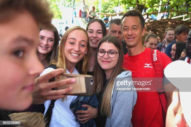 Philipp Kohlschreiber of Germany poses for pictures after his first round match against Ivo Karlovic of Croatia on day 4 of the BMW Open by FWU at...