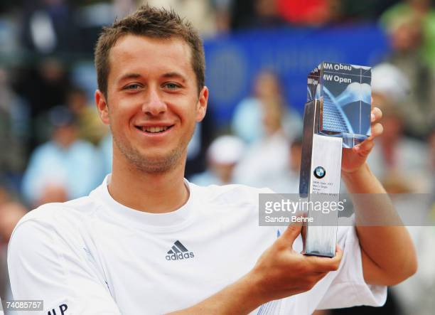 Philipp Kohlschreiber of Germany poses with the trophy after winning the final against Mikhail Youzhny of Russia during the BMW Open at the Iphitos...