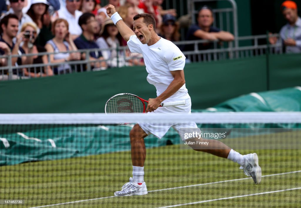 Philipp Kohlschreiber of Germany reacts after winning his Gentlemen's Singles third round match against Lukas Rosol of the Czech Republic on day six of the Wimbledon Lawn Tennis Championships at the All England Lawn Tennis and Croquet Club at Wimbledon on June 30, 2012 in London, England.