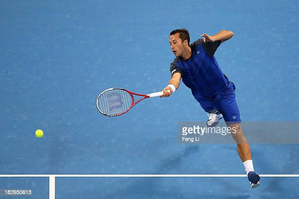 Philipp Kohlschreiber of Germany returns a shot during his men's singles match against Rafael Nadal of Spain on day five of the 2013 China Open at...