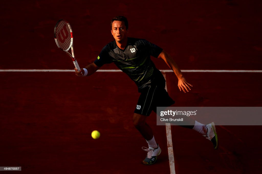 Philipp Kohlschreiber of Germany returns a shot during his men's singles match against Andy Murray of Great Britain on day seven of the French Open at Roland Garros on May 31, 2014 in Paris, France.
