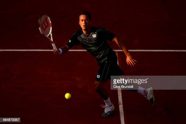 Philipp Kohlschreiber of Germany returns a shot during his men's singles match against Andy Murray of Great Britain on day seven of the French Open...