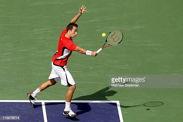 Philipp Kohlschreiber of Germany returns a shot to Robin Soderling of Sweden during the BNP Paribas Open at the Indian Wells Tennis Garden on March...