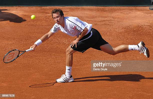 Philipp Kohlschreiber of Germany returns a shot to Tommy Robredo of Spain during day one of the Davis Cup World Group semi-finals in the Plaza de...