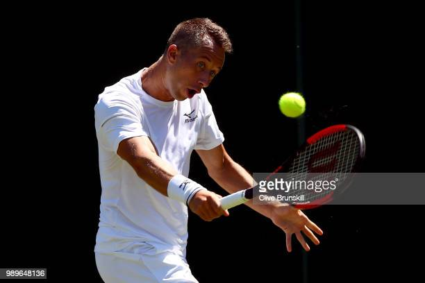 Philipp Kohlschreiber of Germany returns to Evgeny Donskoy of Russia during their Men's Singles first round match on day one of the Wimbledon Lawn...