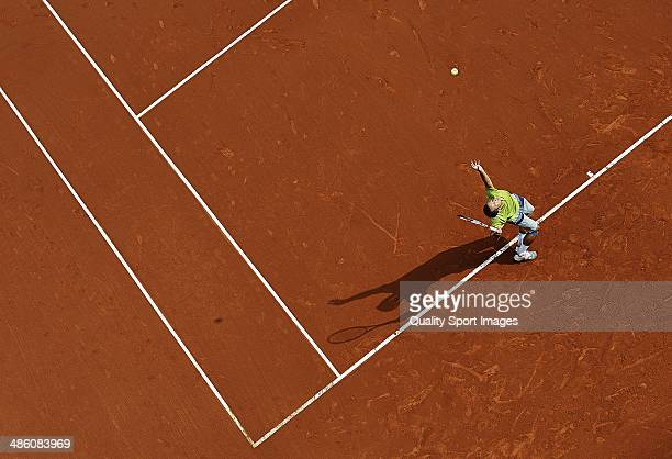 Philipp Kohlschreiber of Germany serves against Edouard Roger-Vasselin of France during day two of the ATP Barcelona Open Banc Sabadell at the Real...