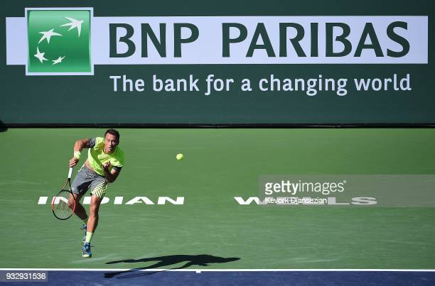 Philipp Kohlschreiber of Germany serves against Juan Martin Del Porto of Argentina during Day 12 of BNP Paribas Open on March 16 2018 in Indian Wells...
