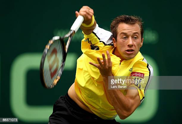 Philipp Kohlschreiber of Germany serves during his first round match against Bjoern Phau of Germany on day 2 of the Gerry Weber Open at the Gerry...