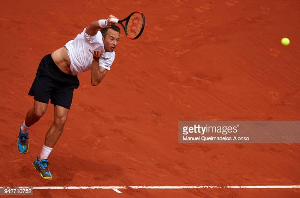 Philipp Kohlschreiber of Germany serves during his match against Rafael Nadal of Spain during day one of the Davis Cup World Group Quarter Final...