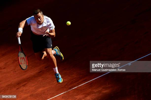 Philipp Kohlschreiber of Germany serves during his match against David Ferrer of Spain during day three of the Davis Cup World Group Quarter Final...