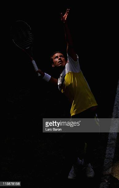 Philipp Kohlschreiber of Germany serves during his semi final against Gael Monfils of France during day 6 of the Gerry Weber Open at Gerry Weber...