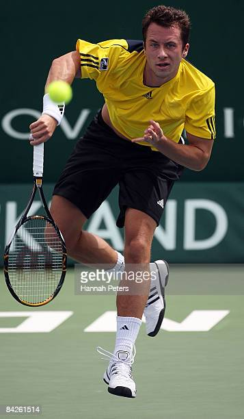 Philipp Kohlschreiber of Germany serves in his match against Dominik Hrbaty of Slovakia during day two of the Heineken Open at ASB Tennis Centre on...
