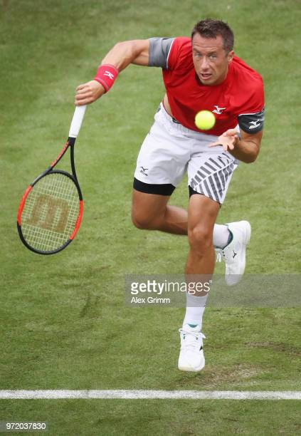 Philipp Kohlschreiber of Germany serves the ball to Denis Istomin of Uzbekistan during day 2 of the Mercedes Cup at Tennisclub Weissenhof on June 12...