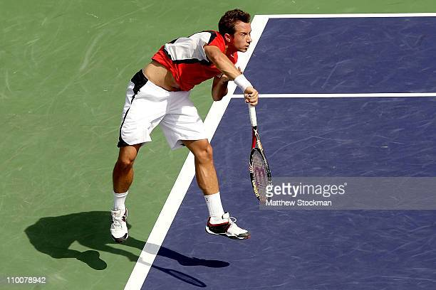 Philipp Kohlschreiber of Germany serves to Robin Soderling of Sweden during the BNP Paribas Open at the Indian Wells Tennis Garden on March 14, 2011...