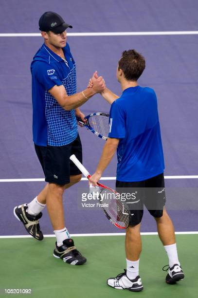 Philipp Kohlschreiber of Germany shakes hand with Andy Roddick of USA after being forced to retire injured during day two of the 2010 Shanghai Rolex...