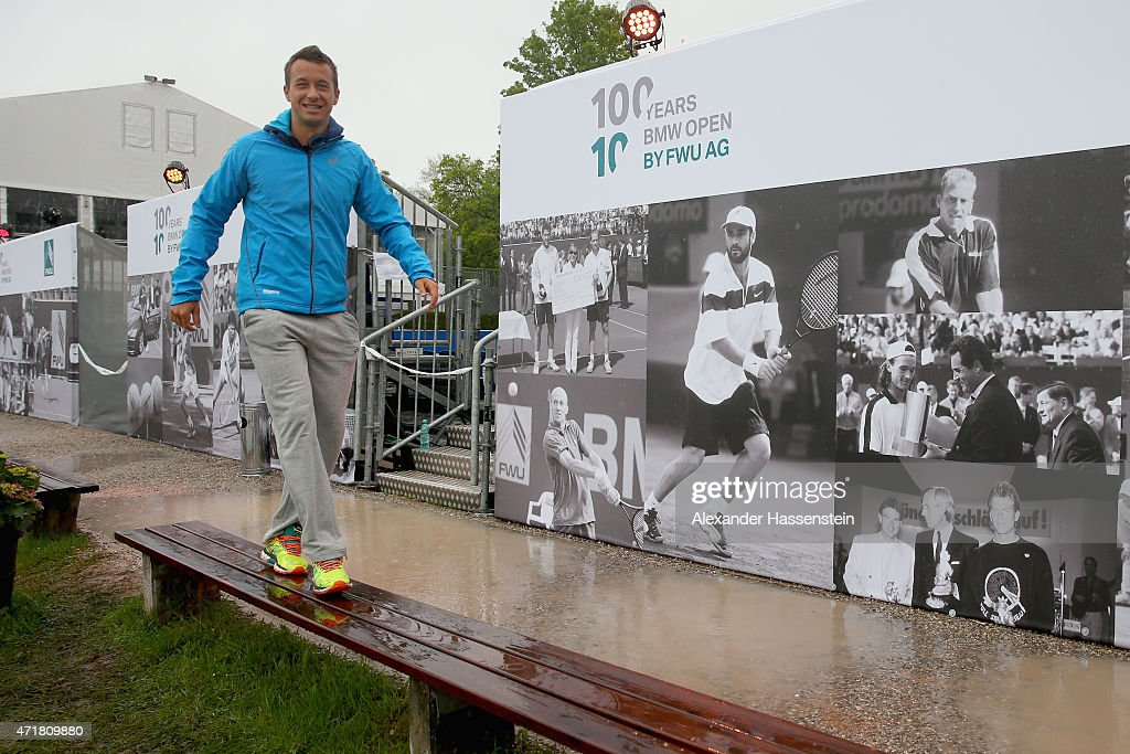 Philipp Kohlschreiber of Germany walks over the tennis club during a weather delay on day 7 of the BMW Open at Iphitos tennis club on May 1, 2015 in Munich, Germany.