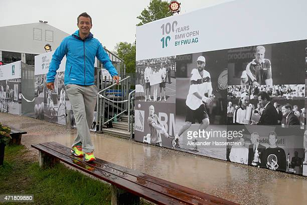 Philipp Kohlschreiber of Germany walks over the tennis club during a weather delay on day 7 of the BMW Open at Iphitos tennis club on May 1, 2015 in...
