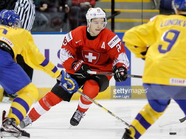 Philipp Kurashev of Switzerland skates against Sweden during a quarter-final game at the IIHF World Junior Championships at the Save-on-Foods...