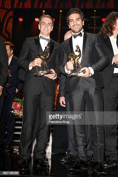 Philipp Lahm and Elyas M'Barek pose with their awards after the Bambi Awards 2014 show on November 14 2014 in Berlin Germany