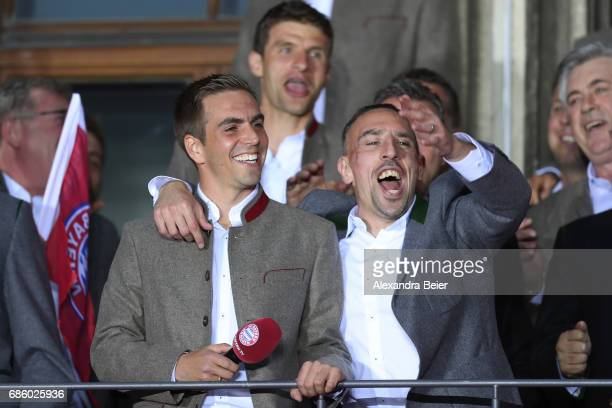 Philipp Lahm and Franck Ribery of Bayern Muenchen celebrate winning the 67th German Championship title on the town hall balcony at Marienplatz on May...