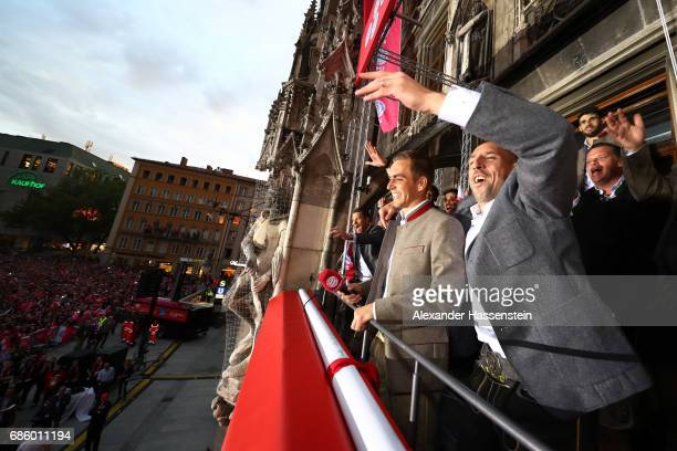 Philipp Lahm and Franck Ribery of Bayern Muenchen speak to the fans as they celebrate winning the 67th German Championship title on the town hall...