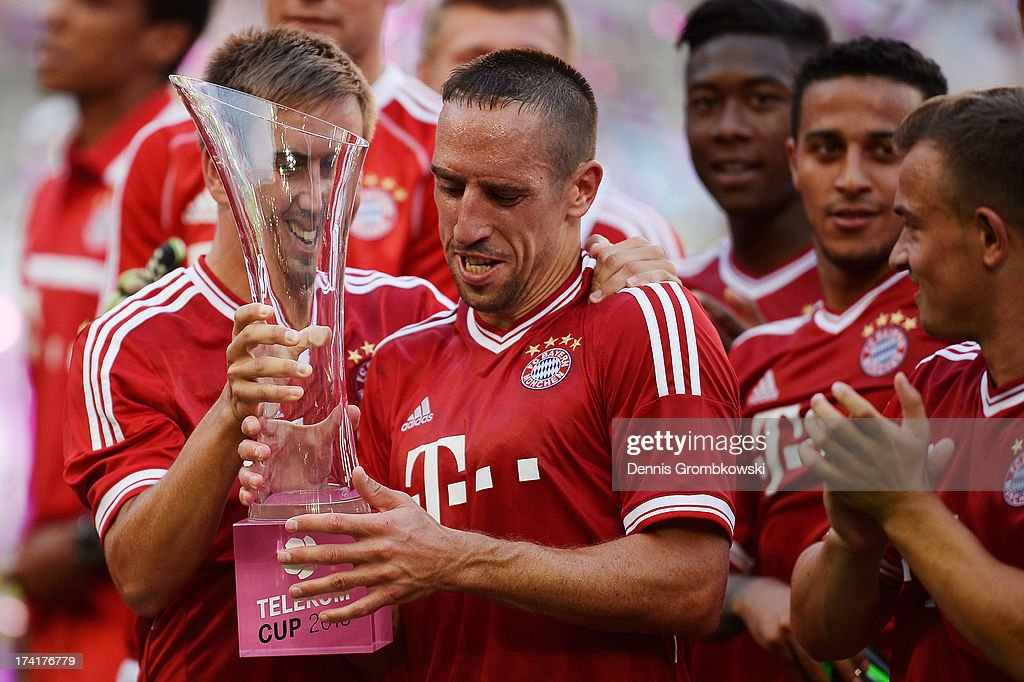 Philipp Lahm and Franck Ribery of FC Bayern Muenchen lift the trophy after the Telekom 2013 Cup final between FC Bayern Muenchen and Borussia Moenchengladbach on July 21, 2013 in Moenchengladbach, Germany.