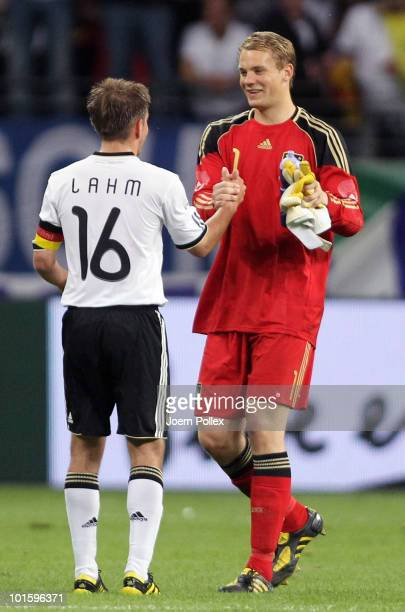 Philipp Lahm and goalkeeper Manuel Neuer of Germany celebrate after the international friendly match between Germany and BosniaHerzegovina at the...