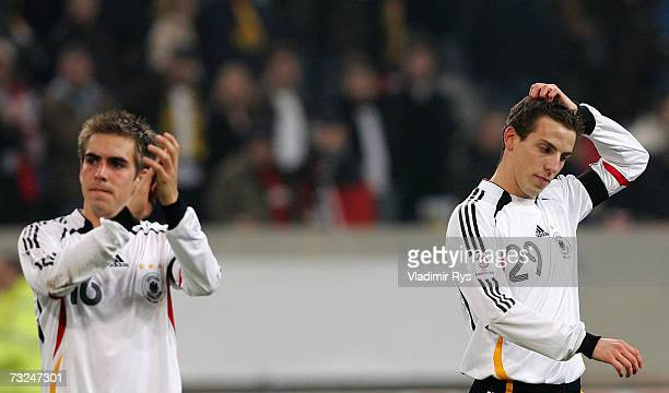 Philipp Lahm and his teammate Jan Schlaudraff of Germany applaud the fans at the end of the friendly match between Germany and Switzerland at the...