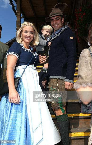 Philipp Lahm and his wife Claudia Lahm and their son Julian Lahm attend the 'FC Bayern Muenchen Wiesn' during Oktoberfest 2015 at Kaeferschaenke on...