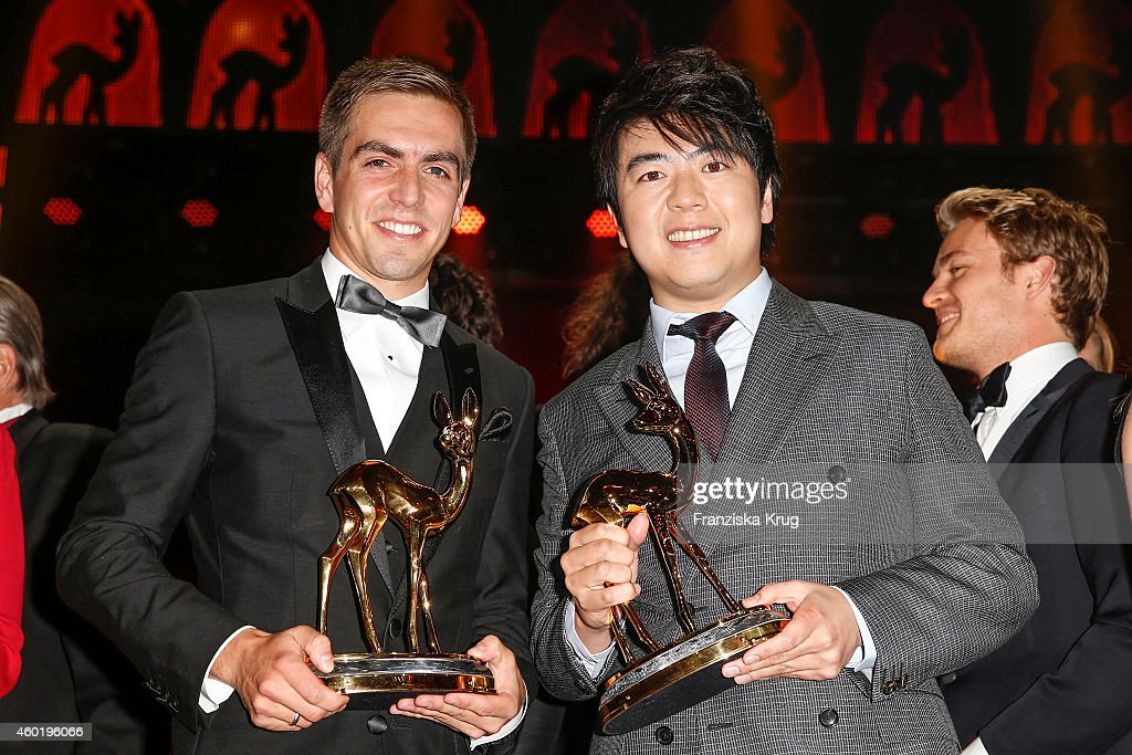 Philipp Lahm (L) and Lang Lang pose with their awards after the Bambi Awards 2014 show on November 14, 2014 in Berlin, Germany.