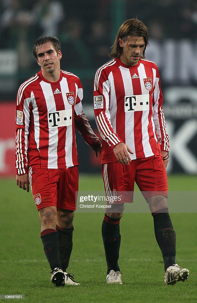 Philipp Lahm and Martin Demichelis of Bayern look dejected after the 3-3 draw of the Bundesliga match between Borussia Moenchengladbach and FC Bayern Muenchen at Borussia Park on November 6, 2010 in Moenchengladbach, Germany.