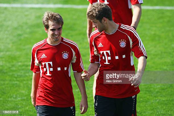 Philipp Lahm and Thomas Mueller chat during a training session of Bayern Muenchen at the ASPIRE Academy for Sports Excellence on January 8 2012 in...