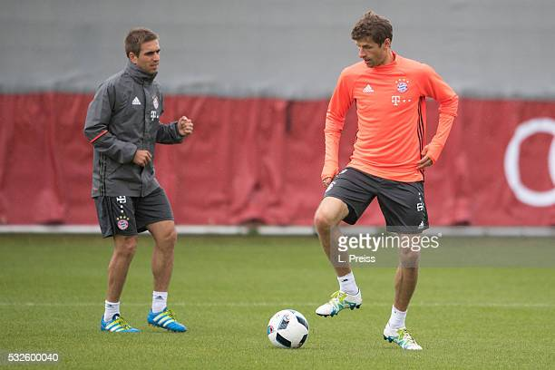 Philipp Lahm and Thomas Mueller of FC Bayern Muenchen in action during a training session on May 19 2016 in Munich Germany