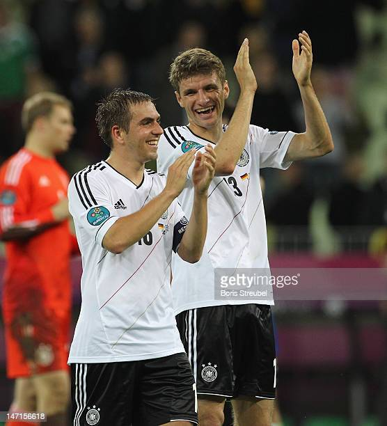 Philipp Lahm and Thomas Mueller of Germany applaud the fans after the UEFA EURO 2012 quarter final match between Germany and Greece at at Municipal...